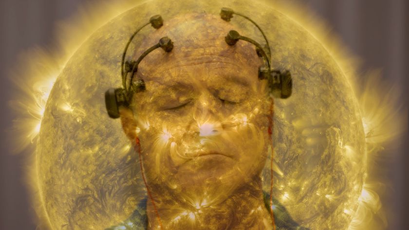 """A stylized image of a man with sensors attached to his head in """"All Light, Everywhere."""""""