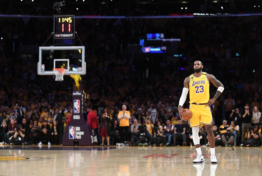 LeBron James holds the ball and lets the 24-second shot clock expire as a tribute to Kobe Bryant to begin a game against the Trail Blazers on Jan. 31 at Staples Center.