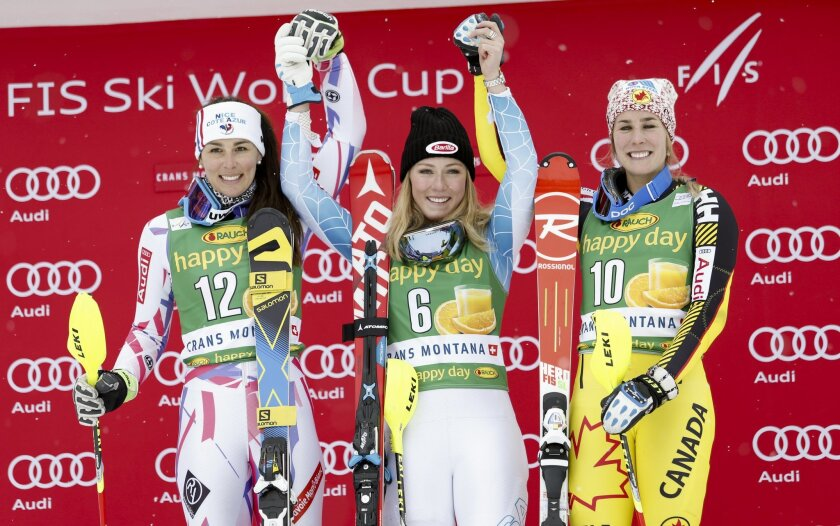 Mikaela Shiffrin, of the United States, center, winner of an alpine ski, women's World Cup slalom, poses on the podium with second placed France's Nastasia Noens, left, and third placed Canada's Marie-Michele Gagnon, in Crans Montana, Switzerland, Monday, Feb. 15, 2016. (AP Photo/Gabriele Facciotti
