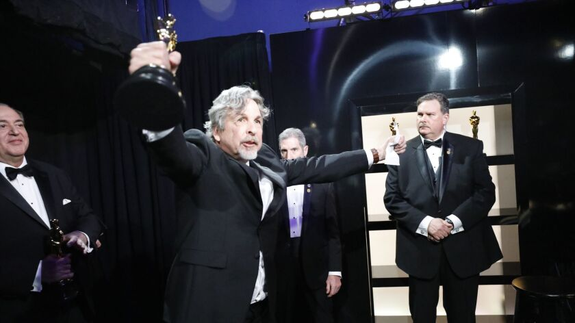 """Peter Ferrelly celebrates one of """"Green Book's"""" wins backstage at the 91st Academy Awards on Sunday at the Dolby Theatre in Hollywood."""