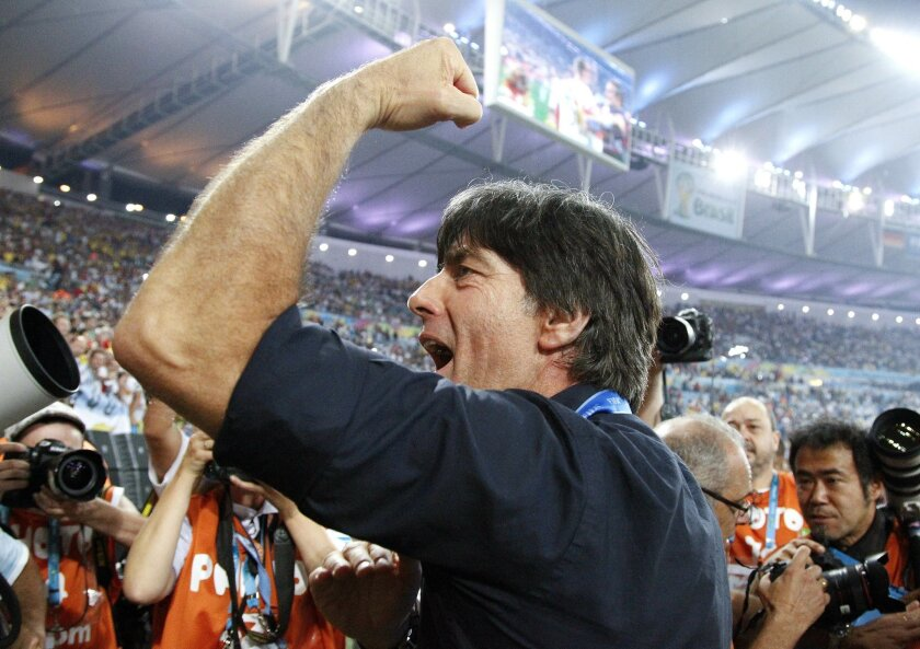 Germany's head coach Joachim Loew acknowledges the cheers during a victory lap after the World Cup final soccer match between Germany and Argentina at the Maracana Stadium in Rio de Janeiro, Brazil, Sunday, July 13, 2014. Germany won the match 1-0. (AP Photo/Matthias Schrader)