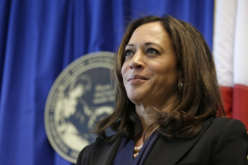 In this photo taken June 28, 2016, California Attorney General Kamala Harris listens to questions during a news conference in San Francisco. California's U.S. Senate candidates pick up dueling endorsements that point to key battlefronts in the race between the fellow Democrats. Harris is backed by