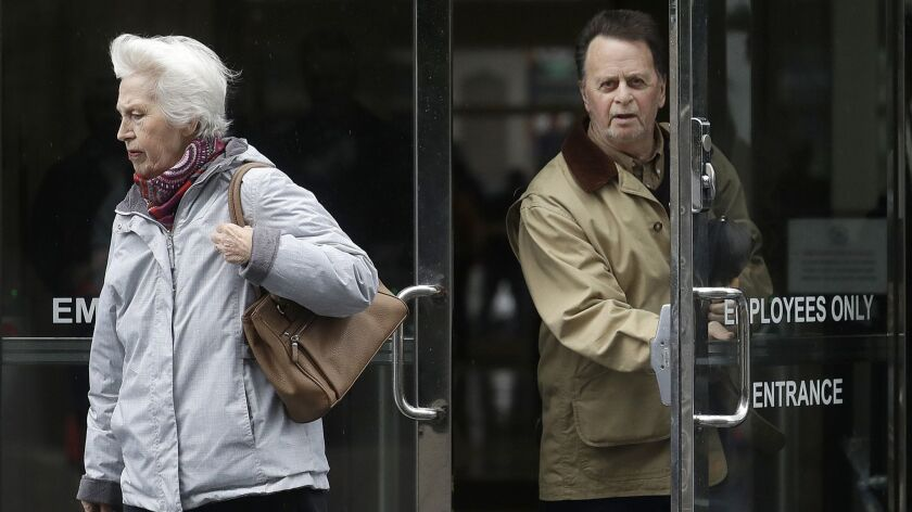 Edwin Hardeman, right, leaves a federal courthouse with his wife Mary in San Francisco, Monday, Feb.