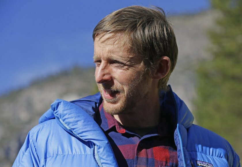 FILE - In this Jan. 15, 2015, file photo,climber Tommy Caldwell speaks during a news conference in El Capitan meadow in Yosemite National Park, Calif. Caldwell, who made history earlier this year with a free-climb in Yosemite National Park, has a book deal. Viking Penguin announced Tuesday, Nov. 3,