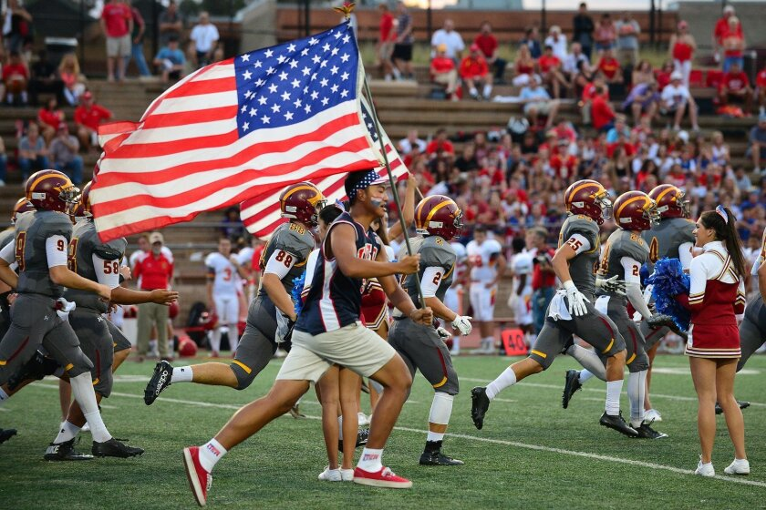 "The Sept. 11 game between Torrey Pines and Cathedral Catholic included a pre-game tribute, ""Salute to America."" Photo by Anna Scipione"