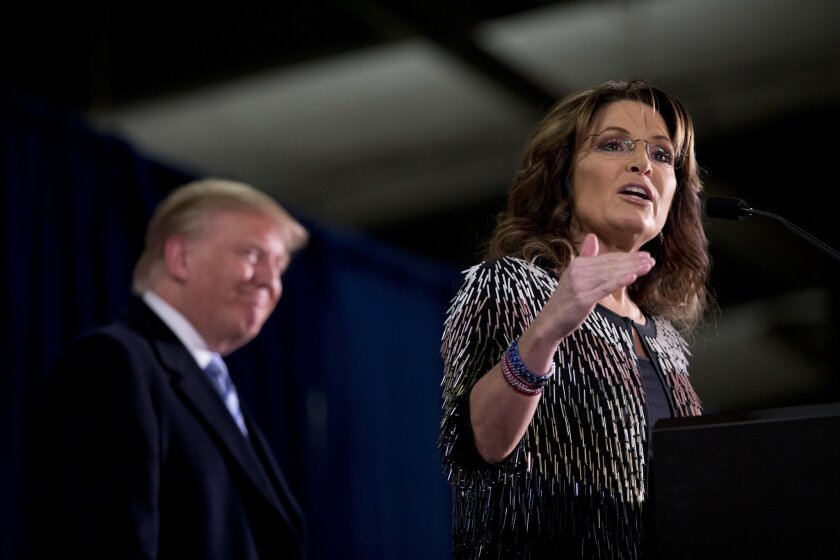 Former Alaska Gov. Sarah Palin endorses Republican presidential candidate Donald Trump during a rally in Ames, Iowa, on Jan. 19.