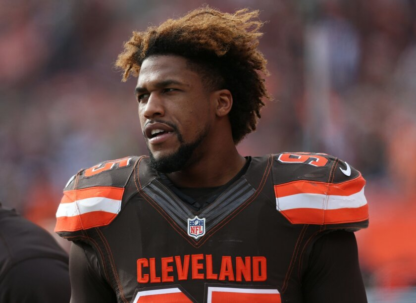 FILE - In this Dec. 6, 2015, file photo, Cleveland Browns' Armonty Bryant (95) watches during the first half of an NFL football game against the Cincinnati Bengals in Cleveland. Bryant has been indicted on two felony drug charges. Bryant and former teammate De'Ante Saunders were arrested on Christm