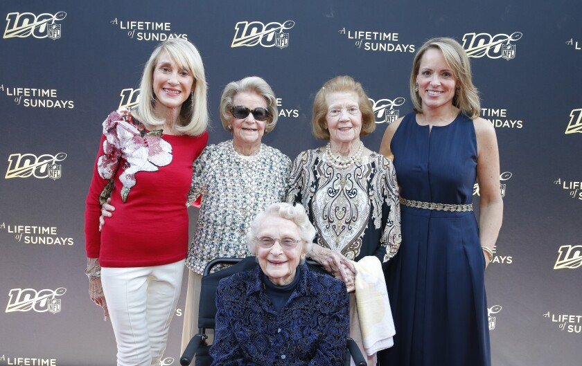 NFL owners, standing from left, Norma Hunt,  Martha Ford and Patricia Rooney, with Jane Skinner Goodell, wife of the NFL commissioner. Seated in front of them is owner Virginia Halas McCaskey.