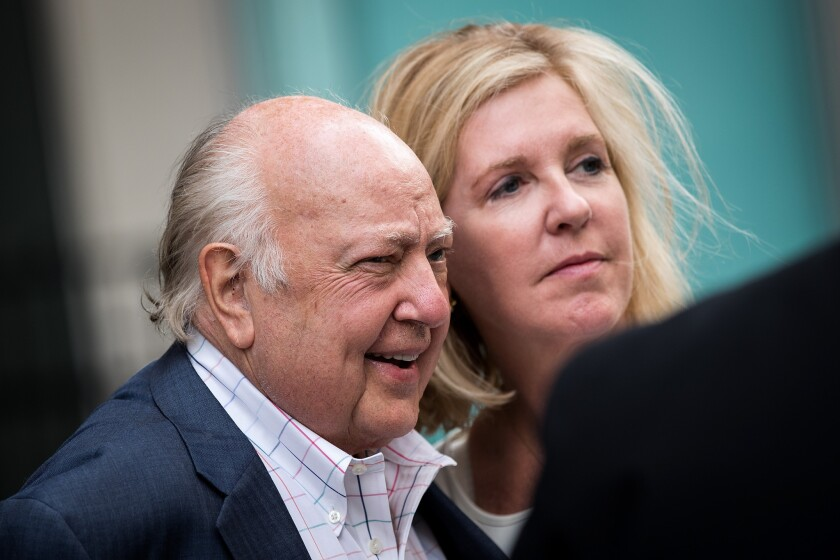 Former Fox News Chief Roger Ailes and his wife, Beth Tilson, leave News Corp. headquarters in New York on July 21.
