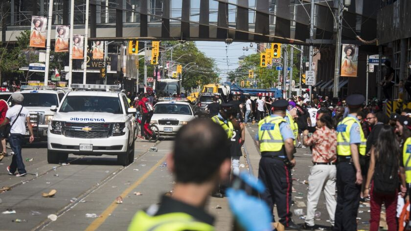 First responders make their way along Queen Street West after reports of shots fired during the Toro