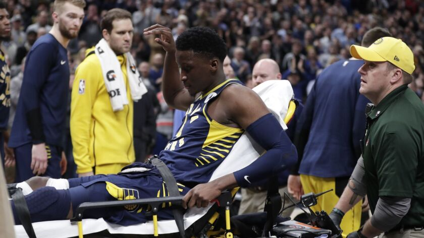 Pacers guard Victor Oladipo is taken off the court on a stretcher after he was injured during the first half of a game against the Raptors on Wednesday.