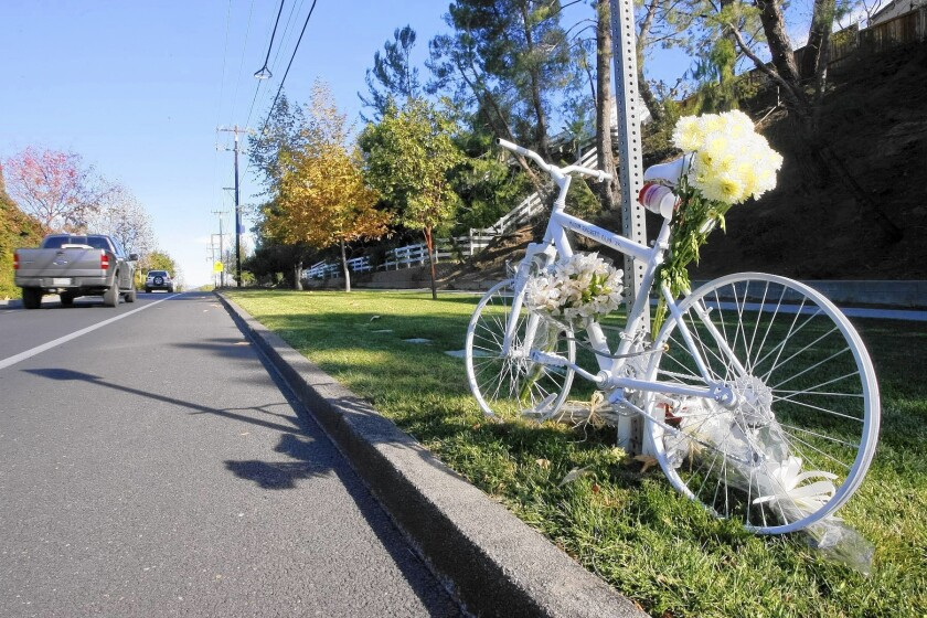 A memorial at the site on Mulholland Drive where a Los Angeles County sheriff's deputy struck and killed Milton Olin Jr. as he was cycling on Dec. 8.