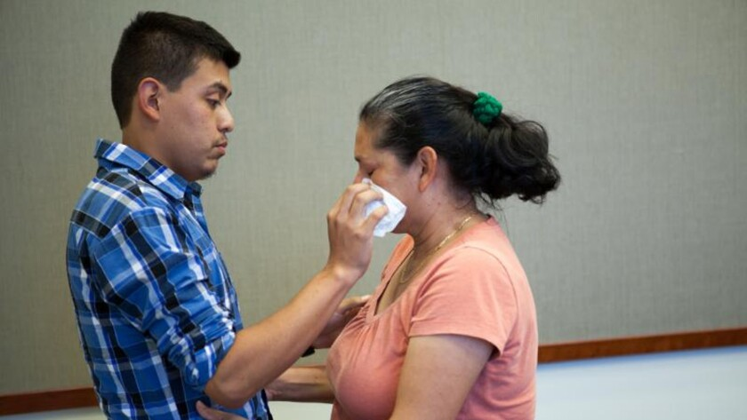 Steve Hernandez, 22, embraces his mom, Maria Mancia, 42, in San Diego.