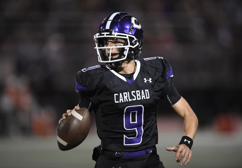Carlsbad's Julian Sayin looks to pass during the first half of the Landers' win over Torrey Pines on Friday night.