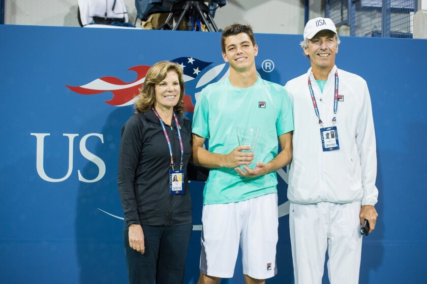 Taylor Fritz (center) with his parents, Kathy May Fritz and Guy Fritz. Photo courtesy of USTA