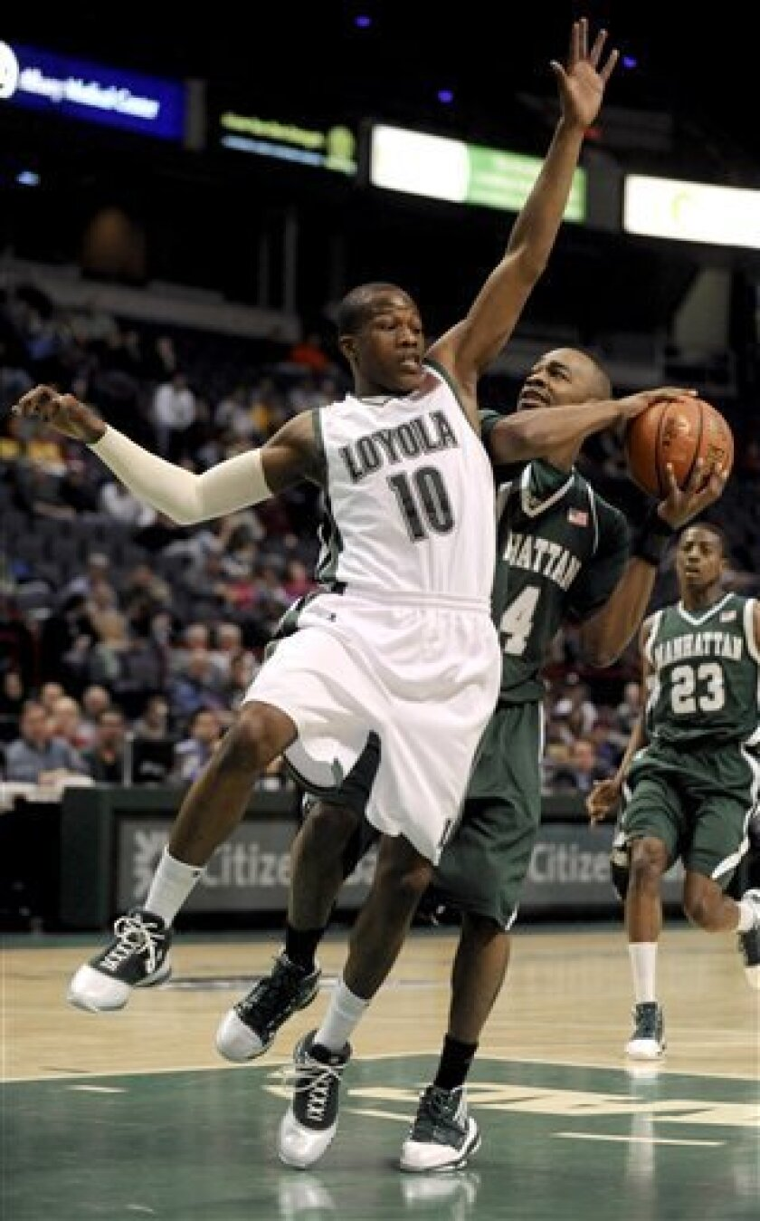 Manhattan's Darryl Crawford, right, shoots behind Loyola's J'hared Hall (10) during the first round of the NCAA Metro Atlantic Athletic Conference men's college basketball tournament in Albany, N.Y., on Friday, March 5, 2010. (AP Photo/Tim Roske)