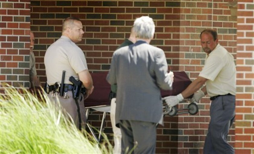 The body of Dr. George Tiller is removed from the Reformation Lutheran Church in Wichita, Kan., Sunday, May 31, 2009. The attorney for  Tiller says the late-term abortion provider was shot and killed at his church in Wichita (AP Photo/Orlin Wagner)