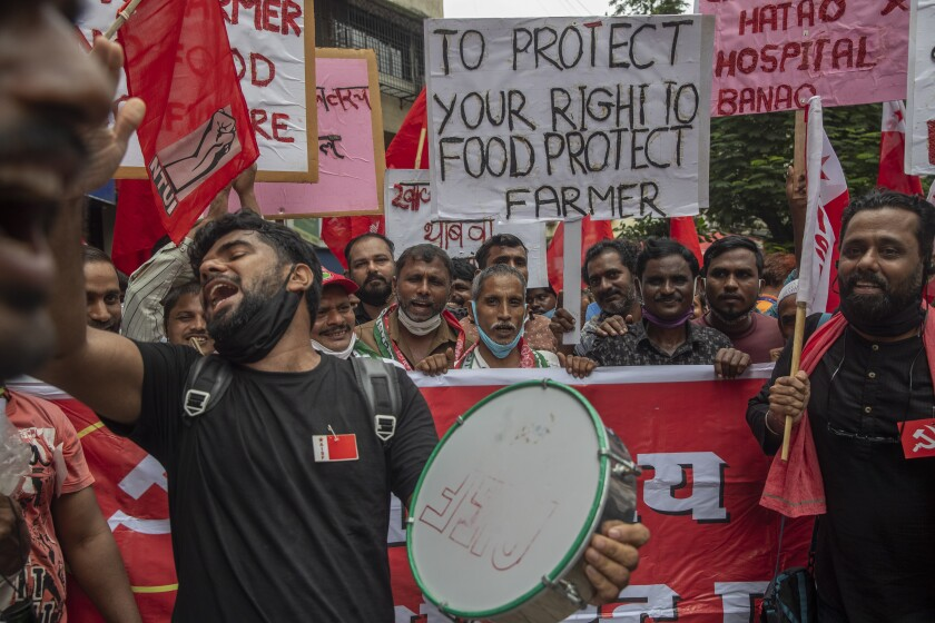 Members of Communist Party of India shout slogans during a protest against farm laws in Mumbai, India Monday, Sept. 27, 2021. The farmers called for a nation-wide strike Monday to mark one year since the legislation was passed, marking a return to protests that began over a year ago. (AP Photo/Rafiq Maqbool)