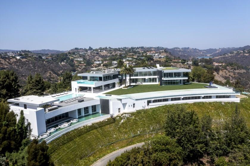 A huge mansion on a hilltop.