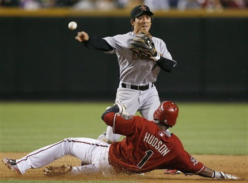 Houston Astros' Kazuo Matsui, top, of Japan, forces out Arizona Diamondbacks' Orlando Hudson as he turns a double play in the sixth inning of a baseball game Tuesday, April 29, 2008, in Phoenix. (AP Photo/Ross D. Franklin)