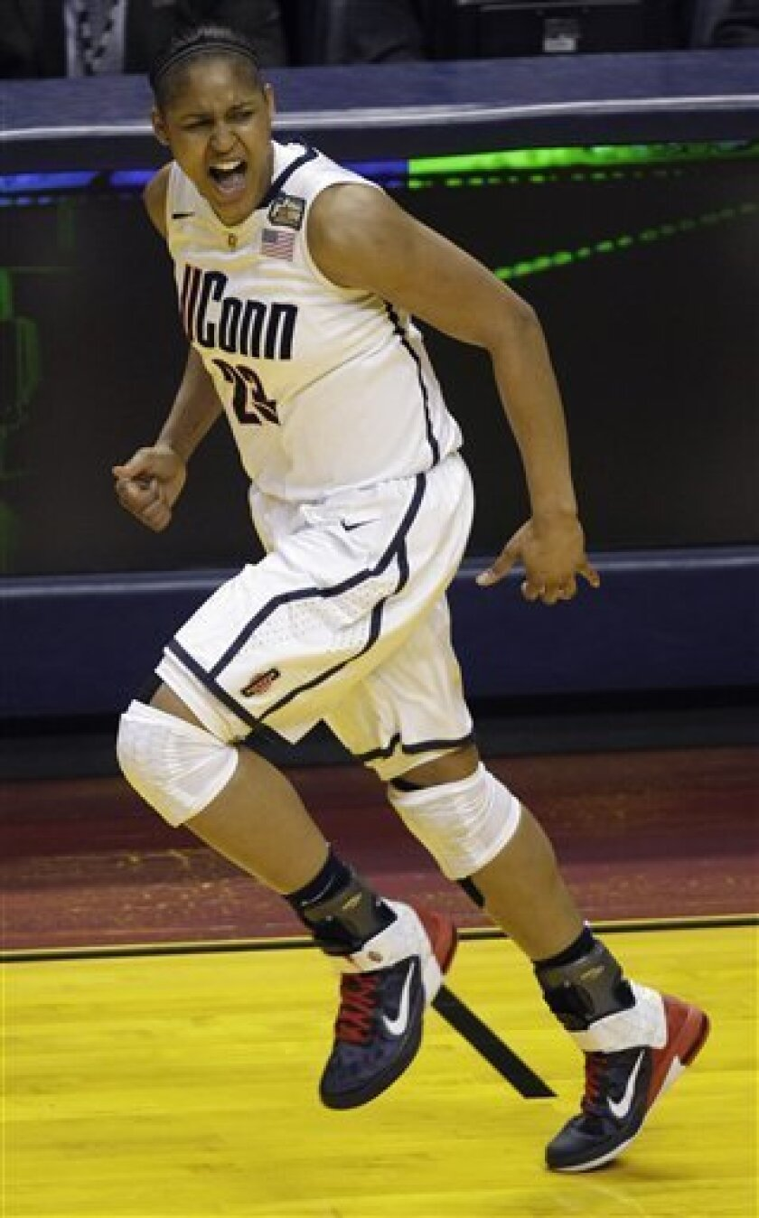 Connecticut's Maya Moore (23) reacts to a play against Notre Dame in the first half of a women's NCAA Final Four semifinal college basketball game in Indianapolis, Sunday, April 3, 2011. (AP Photo/Amy Sancetta)