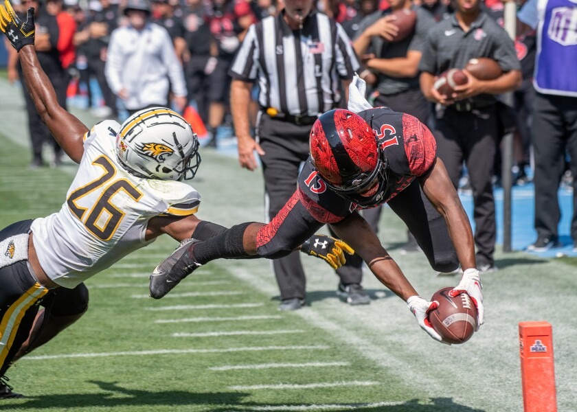 SDSU running back Jordan Byrd reaches the ball into the corner of the end zone while diving for a 12-yard touchdown.