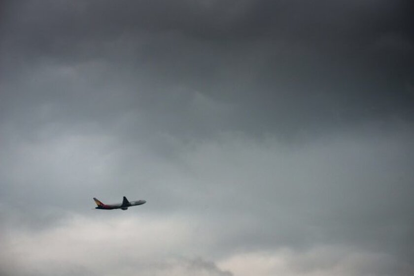 An Asiana Airlines Boeing 777 takes off from Seoul. Federal officials are seeking tighter training rules for foreign pilots who fly in the United States.