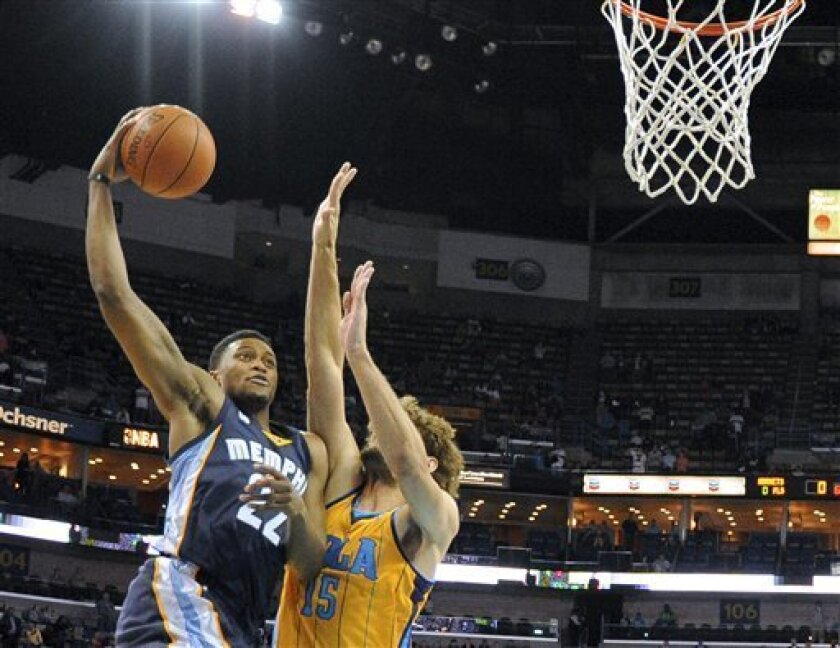 Memphis Grizzlies forward Rudy Gay (22) shoots over New Orleans Hornets center Robin Lopez (15) in the first half of an NBA basketball game in New Orleans, Friday Dec 7, 2012. (AP Photo/Stacy Revere)