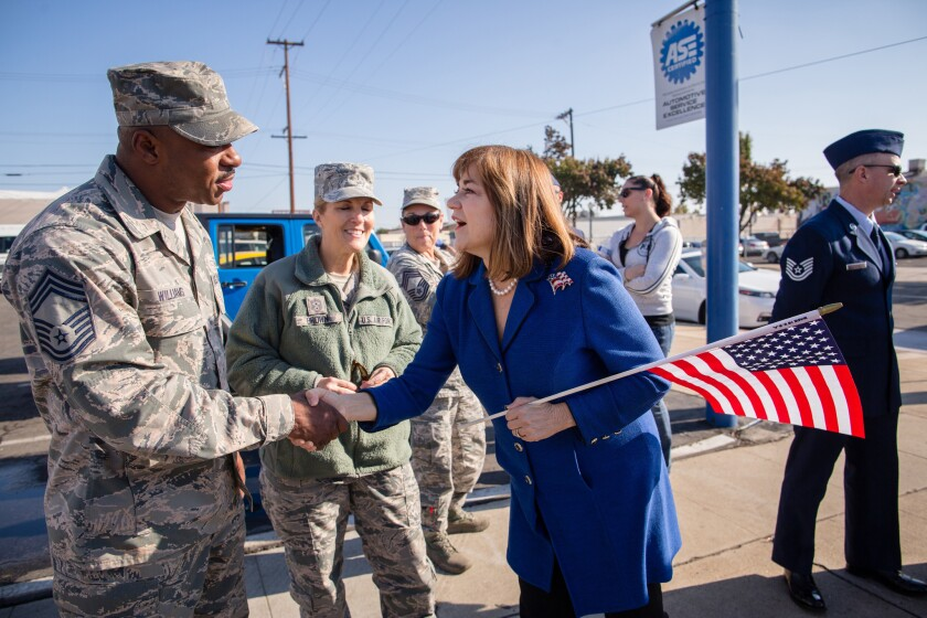 Rep. Loretta Sanchez (D-Santa Ana) attends the Veterans' Day Parade in Fresno and greets members of the military as she campaigns for U.S. Senate.