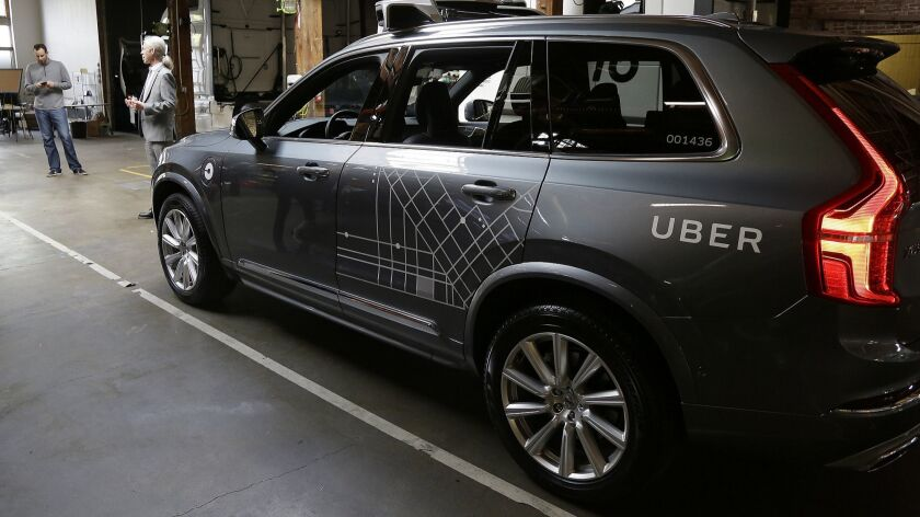 FILE - In this Tuesday, Dec. 13, 2016, file photo, an Uber driverless car is displayed in a garage i