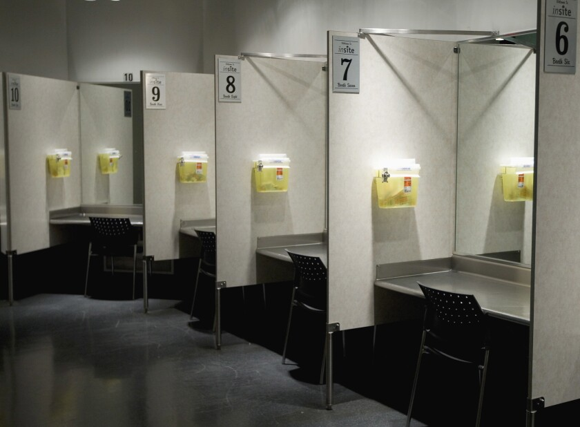 FILE - This Tuesday, May 6, 2008, file photo shows injection booths at a facility in Vancouver, British Columbia, Canada. According to research published in the New England Journal of Medicine on Wednesday, July 8, 2020, a safe haven in the U.S., where drug users can give themselves heroin and other drugs has observed more than 10,500 injections over five years and treated 33 overdoses with none proving fatal. Such facilities may curb deaths from the opioid epidemic, which kills nearly 70,000 people each year in the United States. (Jonathan Hayward/The Canadian Press via AP, File)