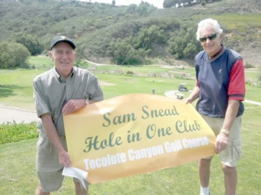 Patrick McGee (left) holds his Hole In One Club recognition banner after hitting his first of two holes in one at Tecolote Canyon Golf Course in December 2013.