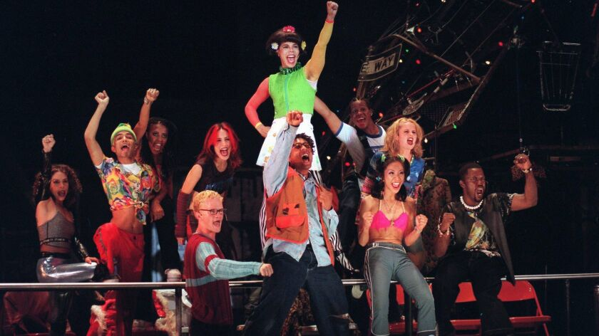 "The cast of La Jolla Playhouse's 1997 production of ""Rent,"" which launched one of the show's first two national tours. Neil Patrick Harris is at front left in red shirt."