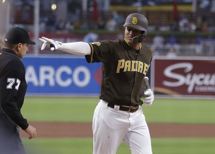 Padres' Manny Machado gestures as he rounds the bases after hitting a two-run home run during the first inning of game against the Los Angeles Dodgers on Friday, May 3, 2019, in San Diego.