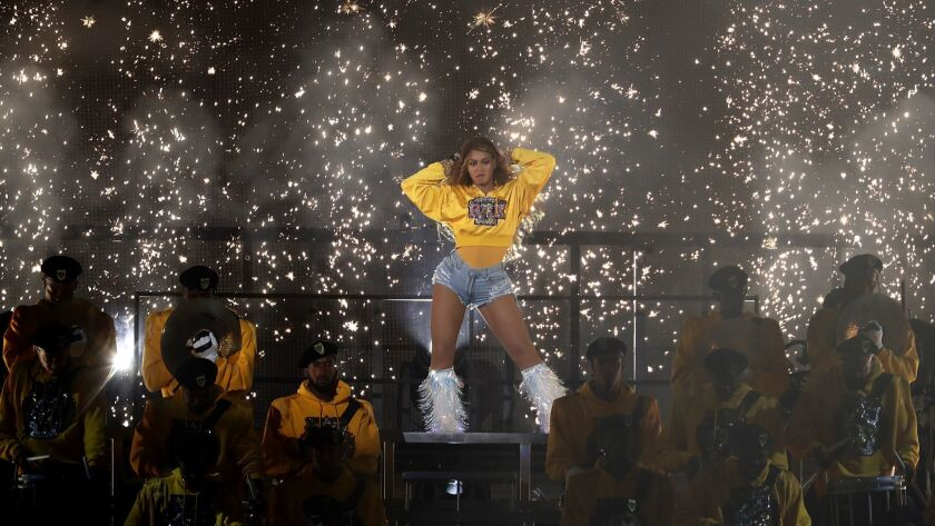 Beyoncé delivers a stunning show from the Coachella stage Saturday night with a little help from Jay-Z and Destiny's Child.