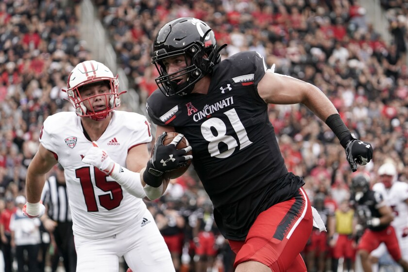 Cincinnati tight end Josh Whyle (81) runs after catching a pass for a touchdown during the first half of an NCAA college football game against Miami (Ohio), Saturday, Sept. 4, 2021, in Cincinnati. (AP Photo/Jeff Dean)