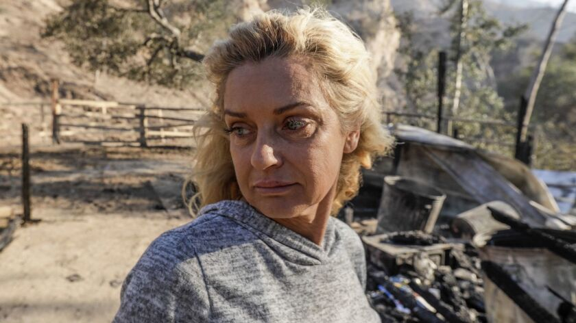 Gail Thackray says she saw sparks flying off a high-voltage transmission tower in Little Tujunga Canyon, where the Creek fire first ignited.