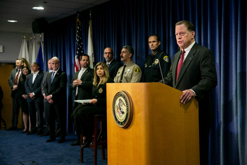United States Attorney Robert Brewer is joined by various law enforcement officials as he announces charges against 19-year-old John T. Earnest on May 9, 2019 in San Diego, California.