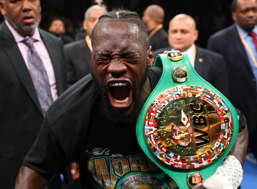 Deontay Wilder celebrates after knocking out Dominic Breazeale.
