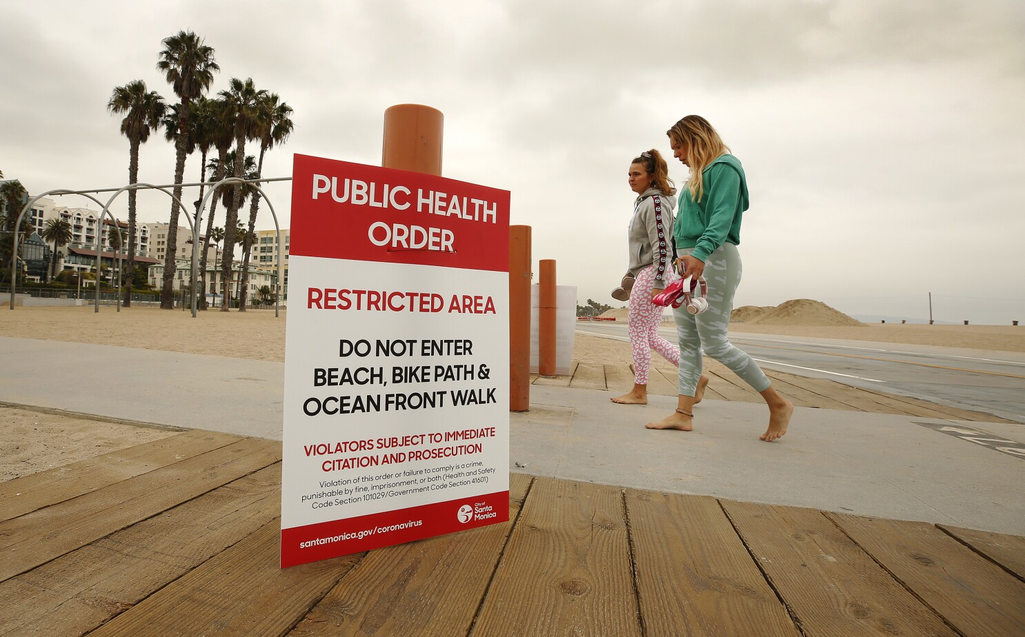 California Coronavirus Restrictions Will Stay For Now Los Angeles Times