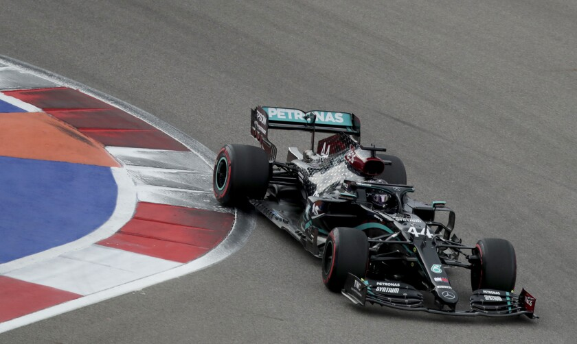Mercedes driver Lewis Hamilton of Britain steers his car during the qualifying session for the upcoming Russian Formula One Grand Prix, at the Sochi Autodrom circuit, in Sochi, Russia, Saturday, Sept. 26, 2020. The Russian Formula One Grand Prix will take place on Sunday. (AP Photo/Pavel Golovkin, Pool)