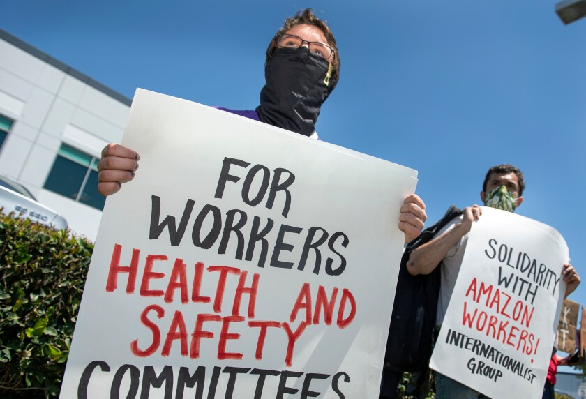 Workers demonstrate at the Amazon delivery hub in Hawthorne on May 1.