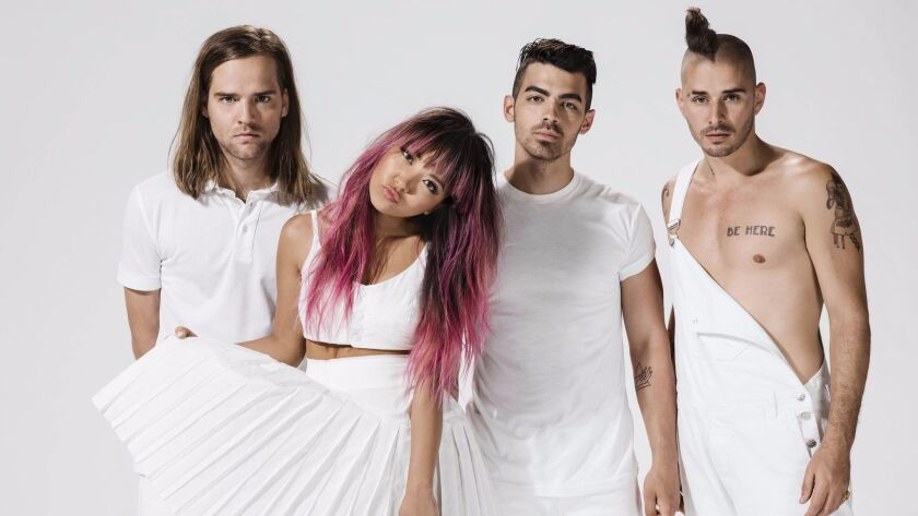 Jonas Brothers co-founder Joe Jonas (second from right) is thriving anew with his band DNCE.