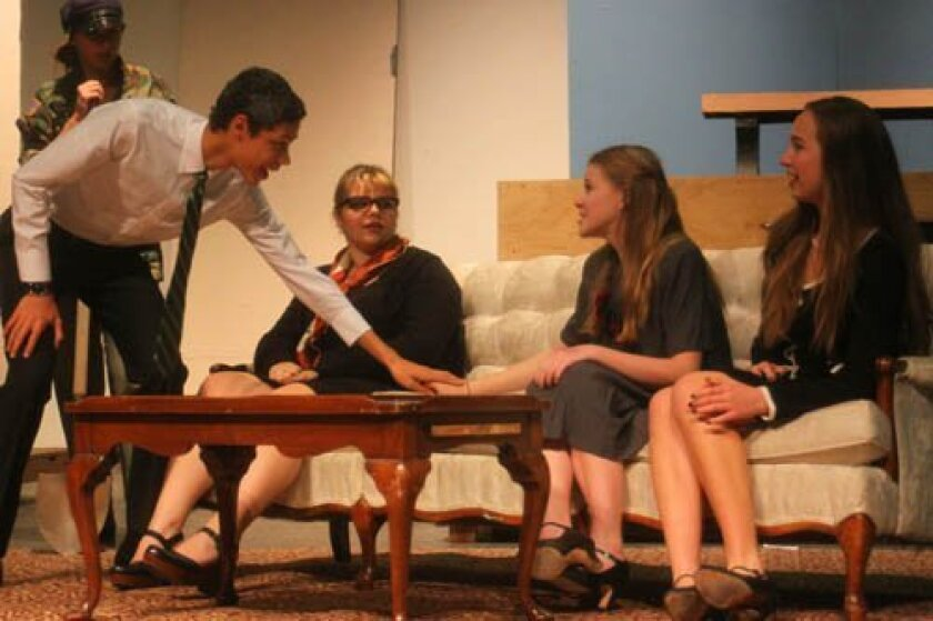 Dan (Tanner Perry) talks to Sarah (Celie Mitchard) when she brings out the sock puppet she uses to communicate. Andrea (Hannah Orr) and Julie (Hannelore Manriquez) watch. Photos by Ashley Mackin