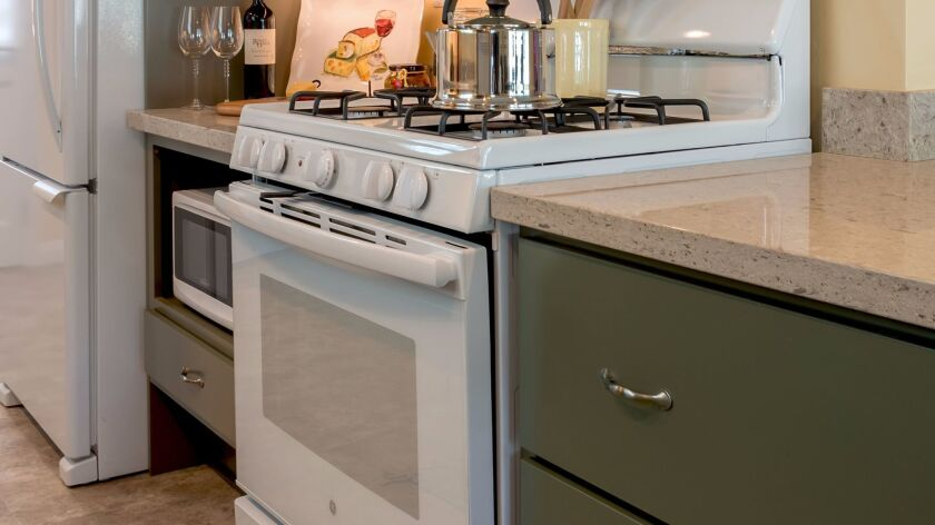 A kitchen remodel from San Diego-based A Kinder Space features appliances close to the ground and dr