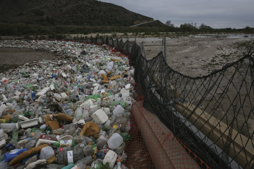Debris gathers in a catch basin on the U.S. side of the border in San Ysidro, Calif. When it rains, trash and raw sewage flow through the Tijuana River Valley to the ocean.