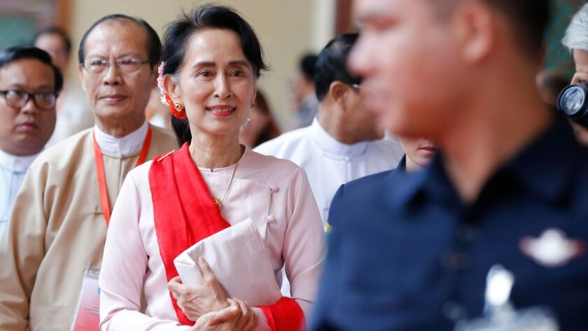 Myanmar's State Counselor Aung San Suu Kyi leaves after attending the Forum on Myanmar Democratic Tr