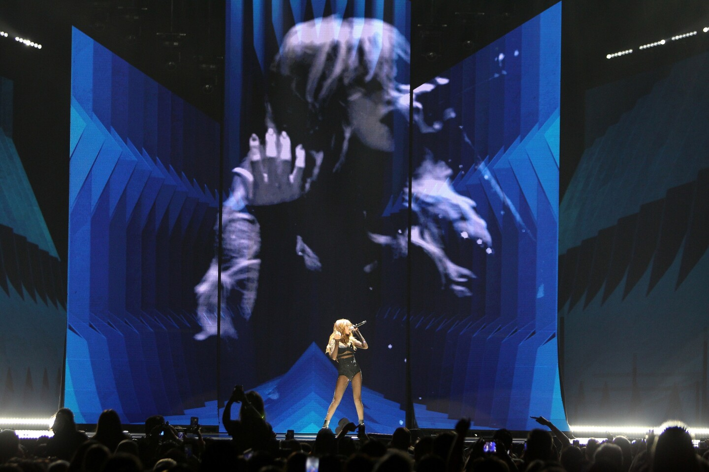 """Selena Gomez performs onstage during her """"Revival Tour"""" at Honda Center on July 09, 2016 in Anaheim, CA. (Photo by © Art. Garcia/DDPixels.com)"""