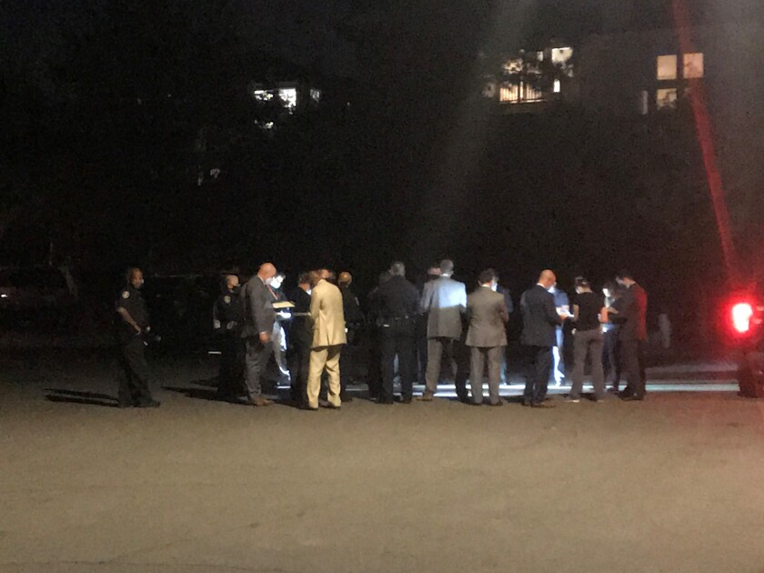 Police gathered Wednesday night on Celtic Court outside a home where an officer shot a domestic violence suspect.