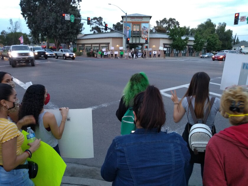 More than 100 people gathered to protest black oppression and police violence in Ramona on Tuesday evening.